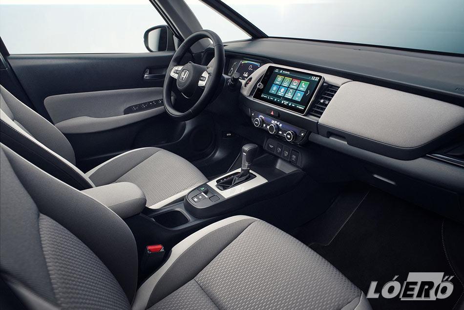A kissé puritánnak tűnő utastér hozza a Honda Jazz hybrid változatánál is tetten érhető.